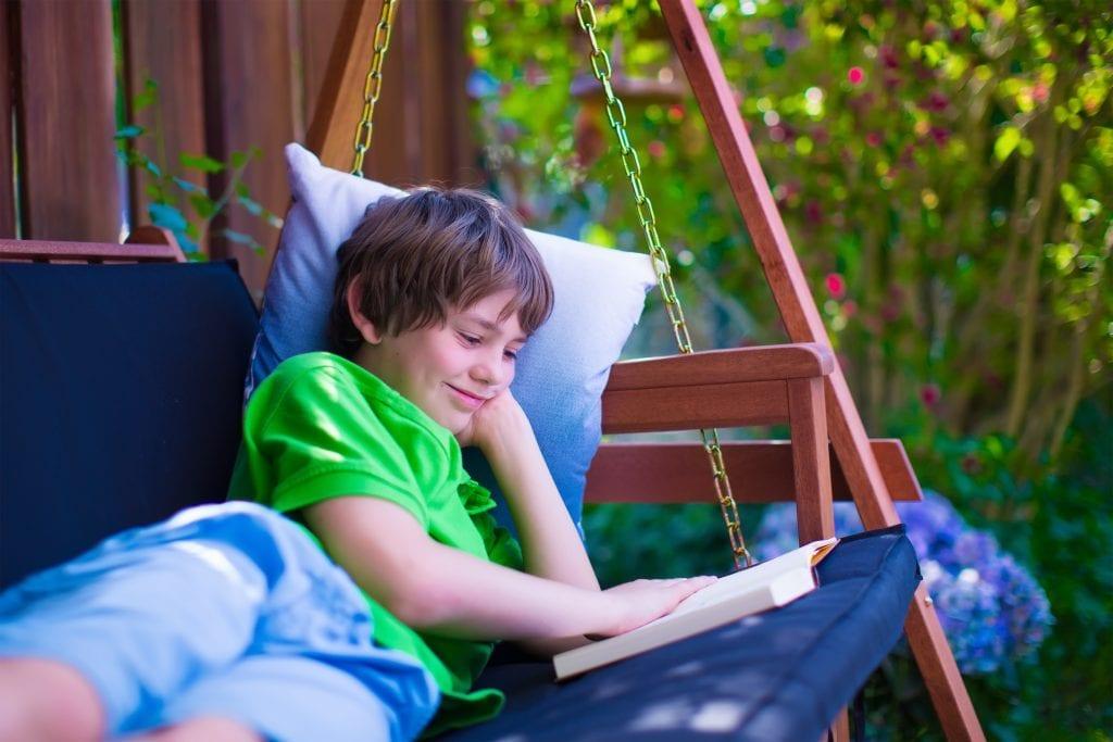 boy reading in summer for summer reading activities